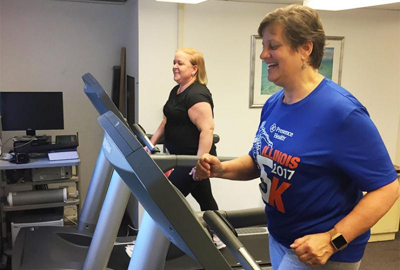 Two people on treadmills