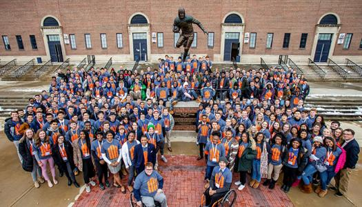 Students gather around Red Grange statue