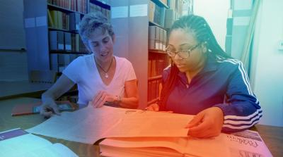 Image of a student collaborating with a researcher