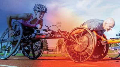 2 wheelchair racers aggresively moving forward