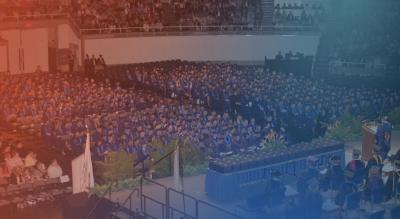 1500 seated students in blue graduation gowns