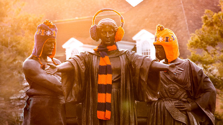 statue of Alma Mater wearing earmuffs